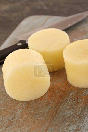 preparing fresh potatoes  on the table