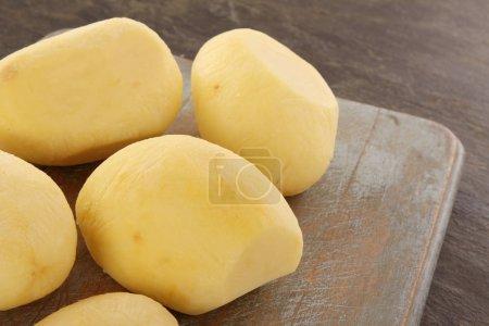 preparing fresh raw  potatoes