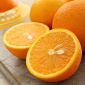 preparing fresh ripe oranges