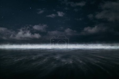 Photo for Breathtaking dark sky and the ocean waves shot in black and white - Royalty Free Image