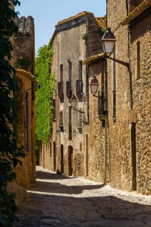 Beautifull narrow street with high buildings. Made...
