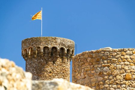 Catelonia flag on tower at Tossa de Mar...