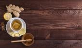 """Постер, картина, фотообои """"Имбирный чай с лимоном меда и корицы на деревянных фоне"""""""