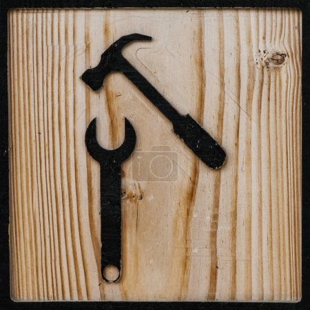 icon of tools made in wood to find the service room