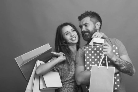 Guy with beard and pretty lady with do shopping