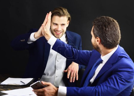 Photo for People in formal suits start partnership. Company leaders have agreement. Happy business partners celebrate success. Men at business meeting. Support, partnership and financial growth concept. - Royalty Free Image
