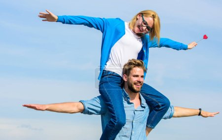 Photo for Couple in love enjoy feeling freedom outdoor sunny day. Couple happy date having fun together. Man carries girlfriend on shoulders, sky background. Lovers enjoy date and feeling free. Freedom concept. - Royalty Free Image