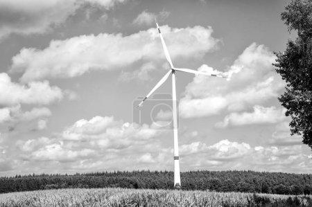 Turbine on field on cloudy blue sky. Wind farm in ...
