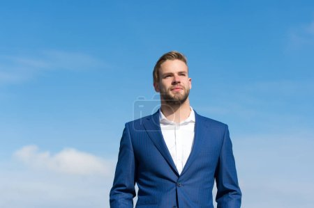 Photo for Businessman successful entrepreneur in suit walks outdoor sunny day, sky background. Man confident and well groomed enjoy freedom. Businessman attractive appearance looks successful. Freedom concept. - Royalty Free Image