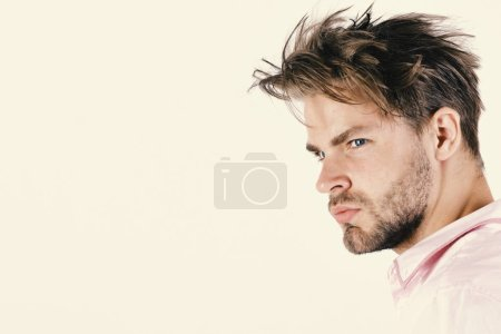 Photo for Masculinity and style concept. Man with confident face isolated on white background, copy space. Guy in pink shirt and messy hair. Macho with bristle looks aside. - Royalty Free Image