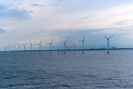 Wind turbines in sea in Copenhagen, Denmark. Offsh...