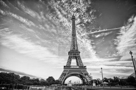 Photo for Eiffel Tower in Paris on beautiful autumn evening. Eifel tower is the symbol of Paris romantic and love - Royalty Free Image