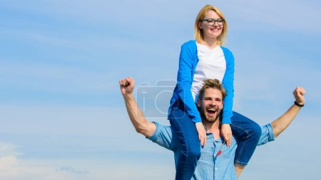 Photo for Soulmates enjoy freedom together. Couple in love enjoy freedom outdoor sunny day. Man carries girlfriend on shoulders, sky background. Couple happy date having fun together. Freedom concept. - Royalty Free Image