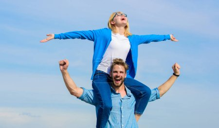 Photo for Soulmates enjoy freedom together. Couple in love enjoy freedom outdoor sunny day. Couple happy date having fun together. Freedom concept. Man carries girlfriend on shoulders, sky background. - Royalty Free Image