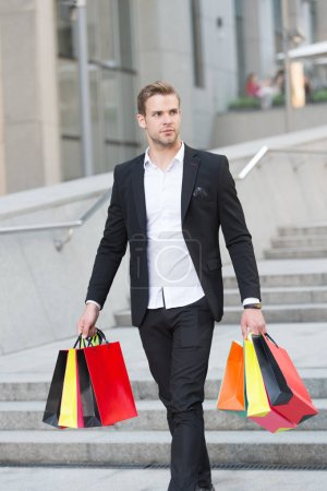 Photo for Luxury shopping. Boutique gallery client. Man shopper carries shopping bags urban background. Successful businessman choose only luxurious brands and shopping in high fashioned boutiques. - Royalty Free Image
