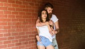 He will never let her go. Couple in love hugs brick wall background. Couple find place to be alone. Couple enjoy intimacy cuddling without witnesses. Girl and hipster romantic date intimacy moment
