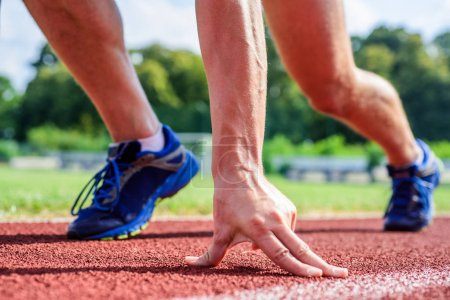 Photo for Runner ready to go close up. Ready steady go concept. At beginning of great sport career. Hand touch track path close up. Hand of sportsman on running track low start position. Starting point. - Royalty Free Image
