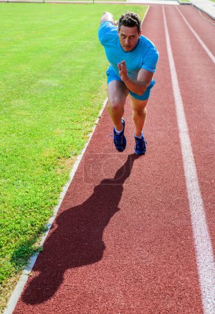 Photo for Runner take part competition motion forward. Focused on sport goal. Ready to achieve victory. Man athlete focused on running race. Runner athlete concentrated try his best. Effort to win sprint race. - Royalty Free Image