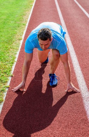 Photo for Runner take part competitions low start position. Focused on sport goal. Ready to achieve victory. Man athlete focused on running race ready to go. Runner athlete concentrated low start position. - Royalty Free Image