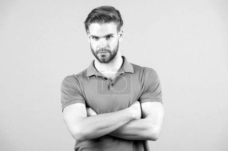 Photo for Macho with folded hands in blue tshirt, fashion. Man with bearded face, blond hair, haircut. Fashion, style, trend. Barber salon, barbershop. Grooming beauty hair care - Royalty Free Image