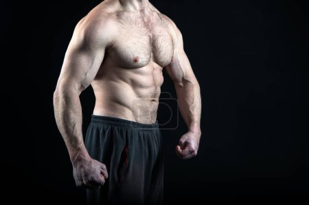 Photo for Torso of man with six pack abs. Workout and exercise abs, copy space. man body - Royalty Free Image