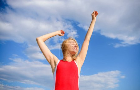 Photo for Enjoy life without sweat smell. Woman blonde relaxing outdoors confident perspirant. Take care skin armpit. Girl pleased with warm sunlight looks relaxed blue sky background. Dry armpit summer goal. - Royalty Free Image