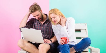 Sincere interest. Show me your progress. Woman interested in working process of boyfriend. Girl supports her man in work. Man working with laptop while girl sit near and supports cheers up
