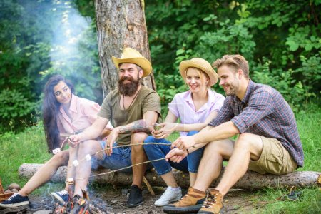 Photo for Hike barbecue. Friends enjoy weekend barbecue in forest. Best friends spend leisure weekend hike barbecue forest nature background. Company friends picnic or barbecue roasting food near bonfire. - Royalty Free Image