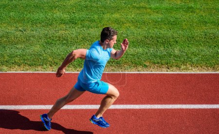 Photo for Athlete run stadium green grass background. Life non stop motion. Runner sporty shape in motion. Sport lifestyle and health concept. Man athlete run to achieve great result. Impulse to move. - Royalty Free Image