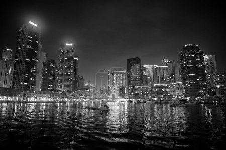 Photo for Dubai, United Arab Emirates - December 26, 2017: Dubai Marina skyline at night. Buildings with lights reflection in water. Architecture or structure and design. Wanderlust and vacation. - Royalty Free Image