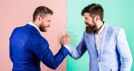 Photo for Business partners competitors office colleagues tense faces ready to compete in arm wrestling. Business competition and confrontation. Hostile or argumentative situation between opposing colleagues. - Royalty Free Image