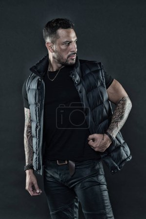 Photo for Tattoo art concept. Macho unshaven brutal wear vest. Man brutal unshaven hispanic appearance tattooed arms. Bearded man posing with tattoos. Masculinity and fashion concept. Tattoo brutal attribute. - Royalty Free Image