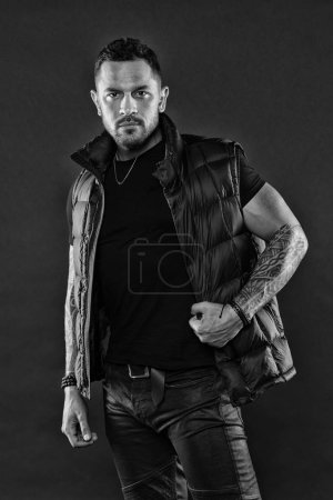 Photo for Tattoo brutal attribute. Tattoo art concept. Macho unshaven brutal wear vest. Man brutal unshaven hispanic appearance tattooed arms. Bearded man posing with tattoos. Masculinity and fashion concept. - Royalty Free Image