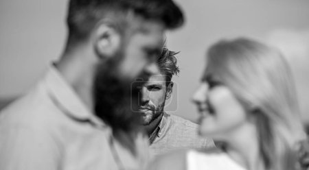 Photo for Couple romantic date lovers flirting. Couple in love happy dating, jealous man watching woman prefers another macho instead him. Broken heart concept. Lovers meeting outdoor flirt romance relations. - Royalty Free Image
