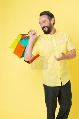 Photo for It is bargain. Bearded man with shopping bags. Happy holidays. shopping. big sale in shopping mall. Mature hipster with beard. brutal caucasian hipster with moustache. Incredible time while shopping. - Royalty Free Image