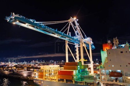 Photo for Miami, USA - November, 23, 2015: freight, shipping, delivery, logistics, merchandise. Maritime container port with cargo containers cranes at night Port or terminal with night illumination - Royalty Free Image