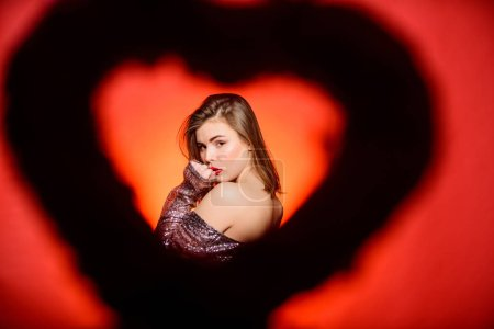 Photo for Love and romance. Valentines day sales. Sexy woman in glamour dress. Sensual girl with decorative heart. Valentines day party. I love you. Romantic greeting. Be my valentine. I believe in love. - Royalty Free Image