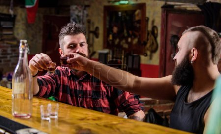 Photo for Friday relaxation in bar. Friends relaxing in bar or pub. Interesting conversation. Hipster brutal bearded man spend leisure with friend at bar counter. Men relaxing at bar. Strong alcohol drinks. - Royalty Free Image