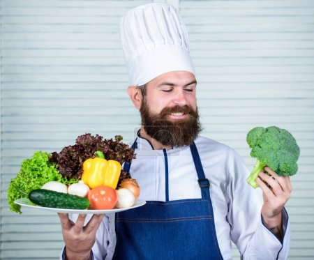 Photo for Hard choice. Vegetarian salad with fresh vegetables. Healthy food cooking. Mature hipster with beard. Cuisine culinary. Vitamin. Dieting organic food. Happy bearded man. chef recipe. - Royalty Free Image