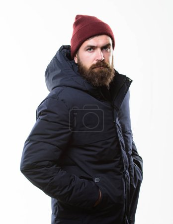Photo for Guy wear hat and black winter jacket. Hipster style menswear. Hipster outfit. Man bearded hipster posing confidently in warm black jacket or parka. Stylish and comfortable. Hipster modern fashion. - Royalty Free Image
