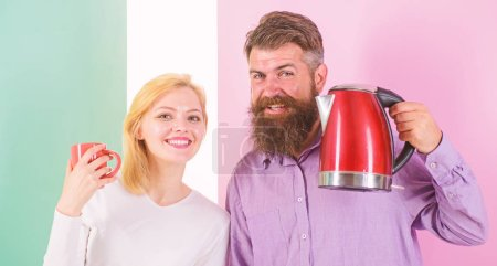 Photo for Starting day together. Modern technology make life easier. Couple prepare morning drink electric kettle. Electric kettle boils water quickly. Prepare drink in minutes. Save time modern technology. - Royalty Free Image