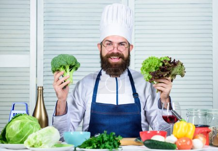 Photo for Photos of food. Vegetarian. Mature chef with beard. Bearded man cook in kitchen, culinary. Chef man in hat. Secret taste recipe. Dieting and organic food, vitamin. Healthy food cooking. - Royalty Free Image
