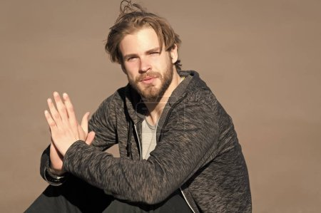 Photo for Bearded man with long blond hair outdoor. Macho with beard in casual sportswear on sunny day. Fashion guy with stylish haircut. Mens beauty at barber and hair salon. Lifestyle for young man. - Royalty Free Image