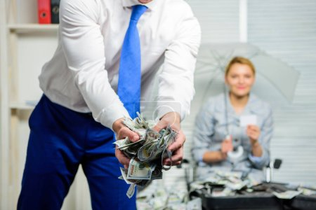 Cash dollar currency office background defocused. Credit loan or profit. Black cash concept. Dollar banknotes crumpled in hands. Crumpled money. Cash in hands of office worker or businessman