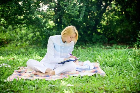 Photo for Business picnic concept. Steps to start freelancing business. Online business ideas concept. Woman with laptop or notebook sit on rug green grass meadow. Business lady freelancer work outdoors. - Royalty Free Image