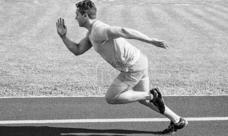 Photo for Runner captured in motion just after start of race. Runner sprint race at stadium. Boost speed concept. Man athlete runner push off starting position stadium path sunny day. How to start running. - Royalty Free Image