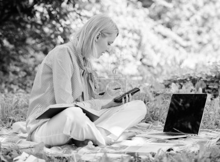 Photo for Managing business outdoors. Woman with laptop sit grass meadow. Business lady freelance work outdoors. Become successful freelancer. Freelance career concept. Guide starting freelance career. - Royalty Free Image