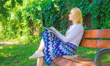 Photo for Lady freelancer working in park. Remote jobs browse top freelance remote work opportunities. Woman with laptop works outdoor green nature background. Girl sit bench with notebook looking new job. - Royalty Free Image