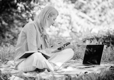 Photo for Become successful freelancer. Managing business outdoors. Woman with laptop sit grass meadow. Business lady freelance work outdoors. Freelance career concept. Guide starting freelance career. - Royalty Free Image