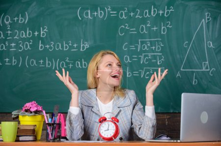 Photo for School. Home schooling. happy woman. teacher with clock at blackboard. Back to school. Teachers day. woman in classroom. Study and education. Modern school. Knowledge day. Business professionals. - Royalty Free Image